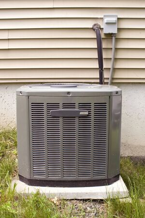 refrigerant: A residential central air conditioning unit sitting outside.