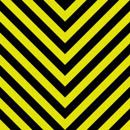 hazard stripes: Yellow hazard stripes texture that is weathered, worn and grunge-looking.  Tiles seamlessly as a pattern in any direction.