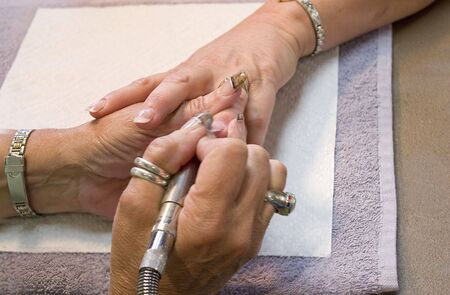 A professional nail technician working on a clients nails. Stock Photo - 3266614