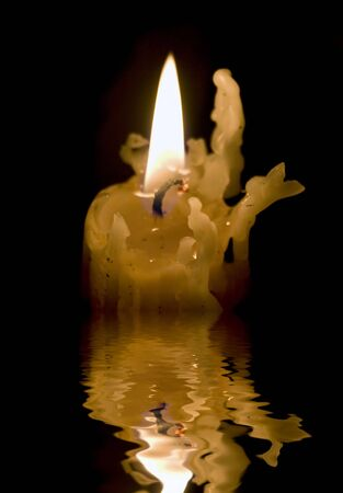 death candle: A creepy, old candlestick burns on as it melts down little by little.