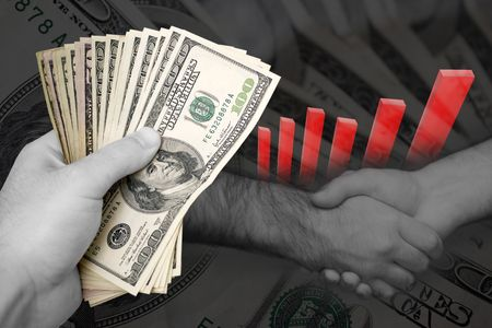 moola: Handful of cash, profit chart, and a firm handshake. A great image to denote profits or successful business dealings.