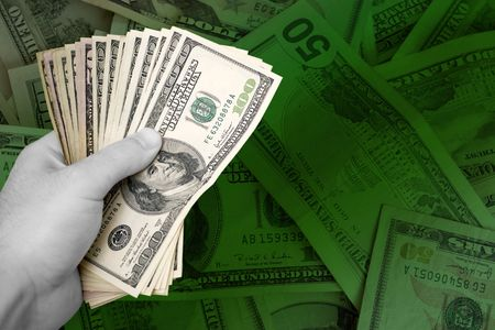 moola: A handful of cash isolated over a green money background.  Plenty of copyspace.