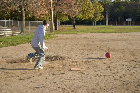 kickball: A friendly game of kick ball at the park - just like at recess back in the day. Stock Photo