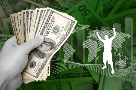 A handful of cash isolated over a business finance themed background. photo