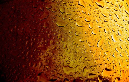 A macro of some water condensation on a glass full of amber colored beer. Stock Photo