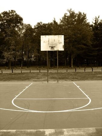 났습니다: A basketball hoop found at the park in sepia tone. 스톡 사진