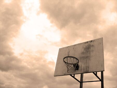 playground basketball: A basketball hoop found at the park in sepia tone. Stock Photo