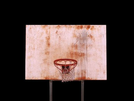 A basketball hoop isolated over black   photo