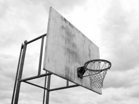 A basketball hoop found at the park in black and white. photo