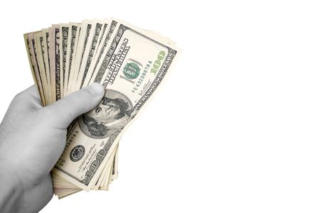 moola: A handful of cash isolated over a white background.  The money has selective color, and the hand is in black and white.