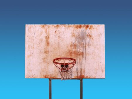 An isolated basketball hoop over a blue background - includes clipping path. photo