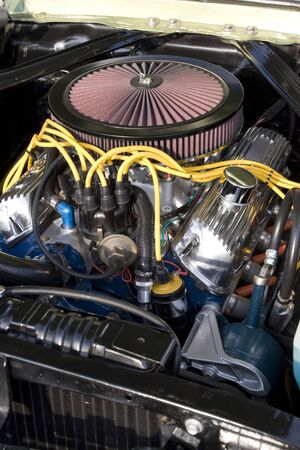 manifold: The engine bay of a classic muscle car. Stock Photo