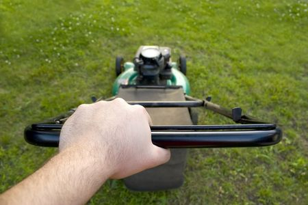 petrol powered: The interesting point of view from a man pushing a lawn mower.