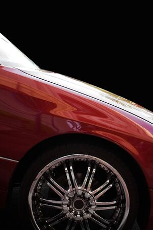 A closeup of a chrome rim on a modern luxury sedan, isolated over black. Stock Photo - 3551673