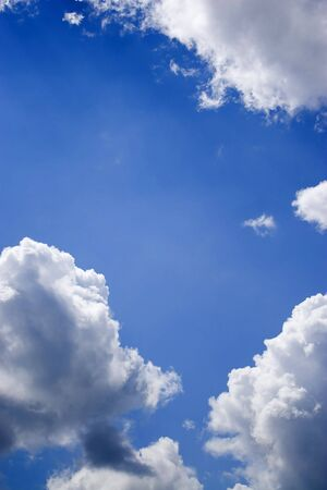 A deep blue sky and perfect cottony clouds with plenty of copy space. Stock Photo - 3563617