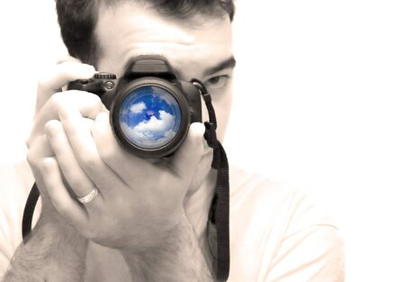 photo studio: A young photographer taking a shot with his DSLR camera.  Selective color and shallow depth of field.