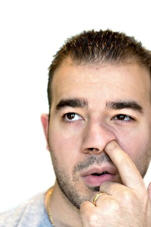 nose picking: A shot of a man digging for gold - the nose picker.