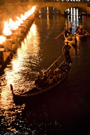 Gondolas on the canal at night during a Providence Rhode Island WaterFire event. Stock Photo