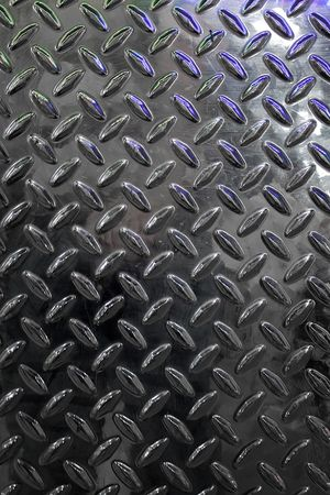 polished: Closeup of real diamond plate material - this is a photo not an illustration.