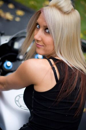 A pretty blonde girl posing on a motorcycle. Stock Photo - 3869851