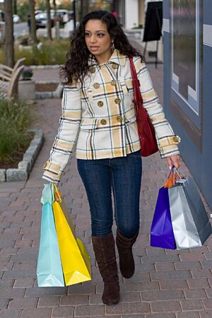 An attractive girl out shopping in the city. Stock Photo - 3869810