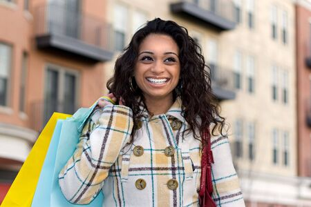 An attractive girl out shopping in the city. Stock Photo - 3869816