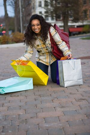 An attractive girl out shopping in the city. Stock Photo - 3869817