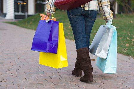 An attractive girl out shopping in the city. Stock Photo - 3869841