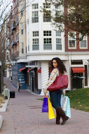 An attractive girl out shopping in the city. Stock Photo - 3869850