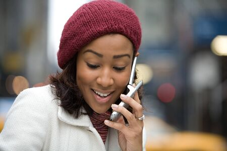 An attractive business woman talking on her cell phone in the city. photo