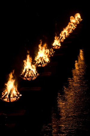 cruis: A shot of the burning bowls of fire set on the river during the annual WaterFire event in Providence, Rhode Island.