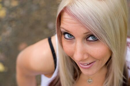 A closeup of a pretty blond woman from a higher angle. Stock Photo - 3971527