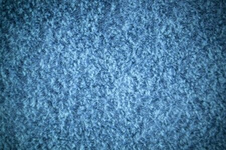 carpet and flooring: A blue shag carpet texture with added vignetting. Stock Photo
