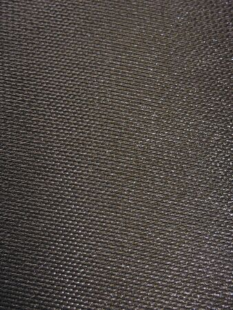 gunmetal: Real carbon fiber in its raw form - this is the material that is used to make durable and light weight parts. Stock Photo