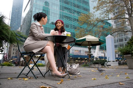 Two business women having a casual meeting or discussion in the city.  Stock Photo