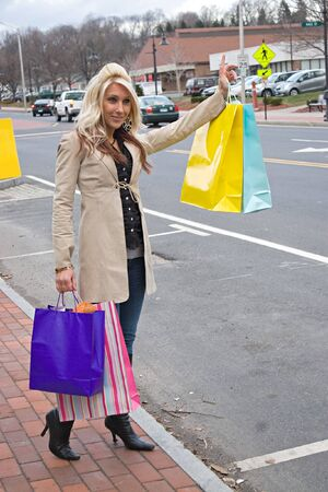 hailing: An attractive girl out shopping in the city. Stock Photo