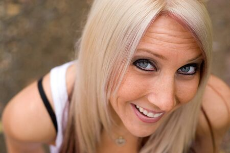 A closeup of a pretty blond woman from a higher angle. photo