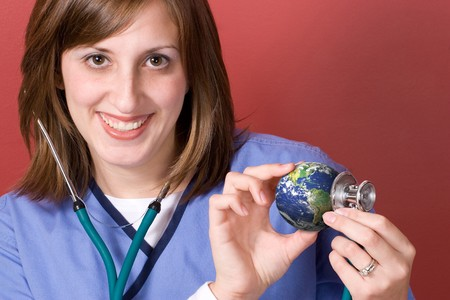 A young nurse holds a stethoscope to the earth.  This conceptual image works great for the going green movement. Stock Photo - 4120468