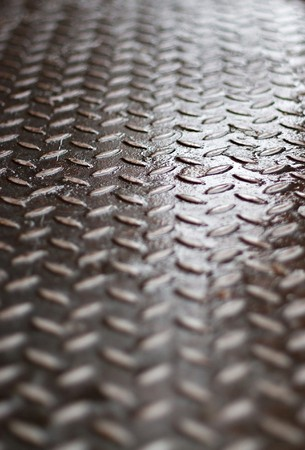 steel sheet: Closeup of real diamond plate material - super shallow depth of field.