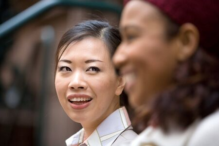 Two business women having a casual meeting or discussion in the city. Shallow depth of field. Stock Photo - 4220182