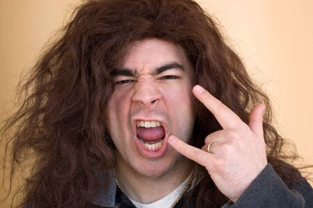 A rocker dude goes wild and starts head banging. photo