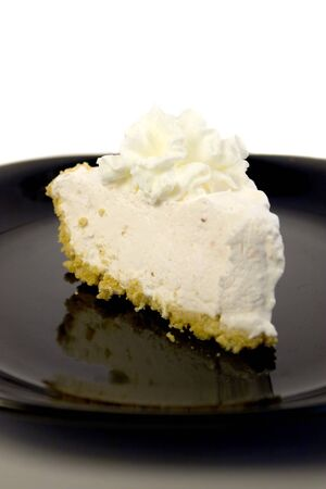 graham: A slice of strawberry cheesecake with whipped cream and a graham cracker crust. Stock Photo