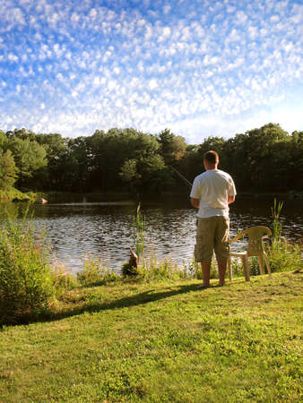 A lone fishermen fishing in a rural pond. Stock Photo - 4358641