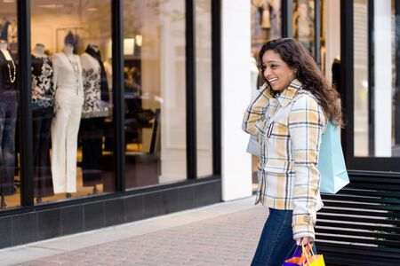 window shopper: An attractive girl out shopping  in the city.