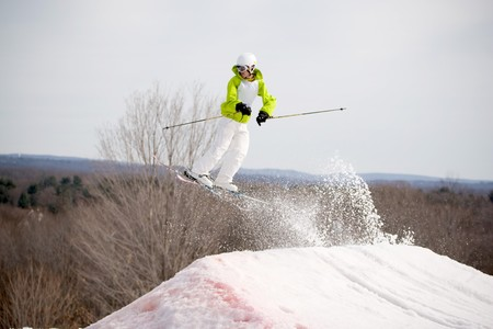 A skier catching some major air after launching off of a jump. photo