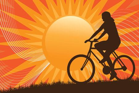 Une silhouette d'une personne faire du vélo devant le soleil. Banque d'images - 4463636