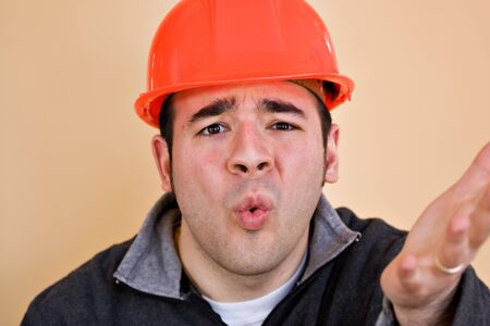 This construction worker is frustrated and confused about something. photo