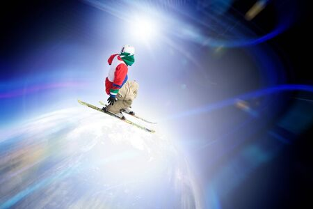 zoom earth: Abstract skier catching some major air flying through outer space. Stock Photo