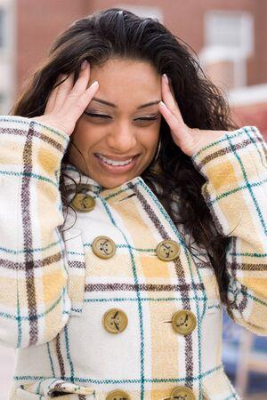 This woman is experiencing an intense headache. photo