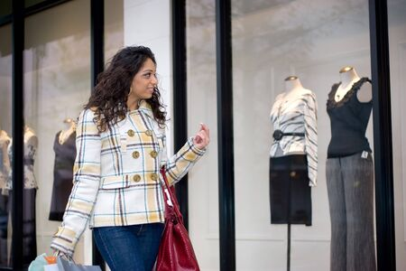 window shopper: An attractive girl out shopping in the city. Stock Photo